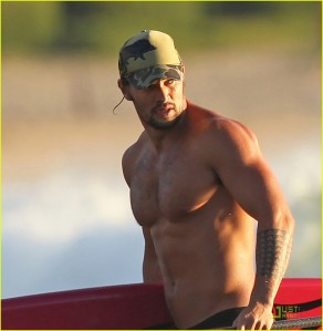 EXCLUSIVE: A shirtless Jason Momoa coming in from a surf session in Hawaii.